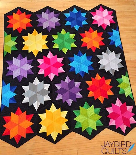 Night Sky Revisited | Jaybird Quilts   want to use colors in grey, orange, purple and dark blues on the black background.