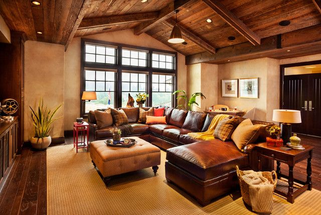 Remarkable Rustic Family Room Design with Dark Brown Colored Leather Sectional Sofa and Bright Cream Colored Floor Mat