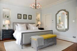 Minimalist meets scandinavian style: This bedroom doesn't have much furniture, but a lot of style! That small chandelier is unusual for a bedroom - and that's exactly what is special about that room.     Seen by Ruth Noble Interiors.