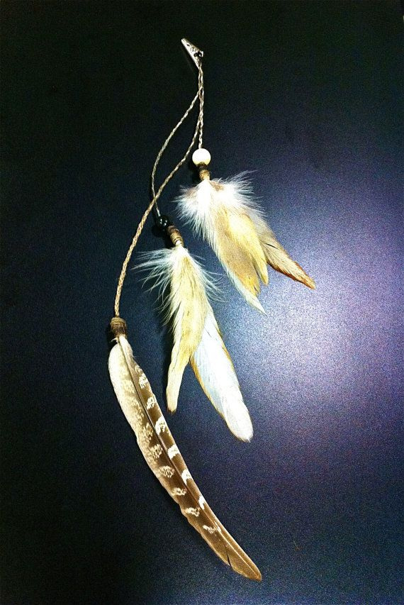 "Yes, we ""innocently"" pinned feathers into our hair... Roach clip + feathers = hair accessory, Duh."