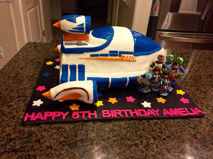 Miles from Tomorrowland cake idea: Space shuttle cake with miniature figures.