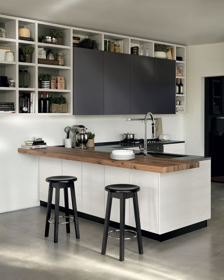 """This composition with peninsula, """"Melting"""" breakfast/snack top (Vintage Oak veneer) and a """"Fluida"""" wall system characterized by open and closed front units: Selfmotion wall units and undermounted sink with mixer tap."""