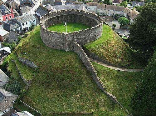 """Totnes Castle, Totnes, Devon England.  The surviving stone keep and curtain wall date from around the 14th century. Totnes Castle is one of the best preserved examples of a Norman motte (as in """"motte and bailey"""" castle) in England."""