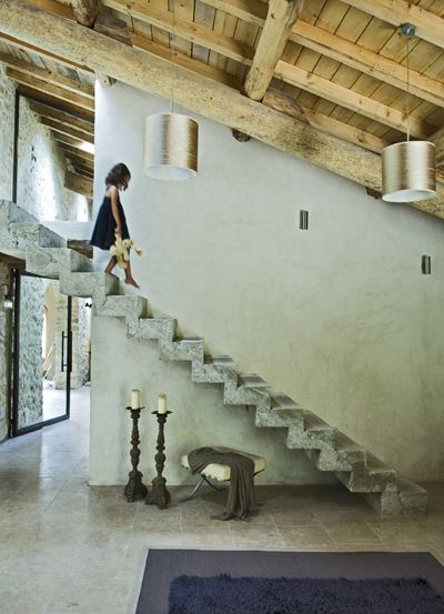 Gorgeous concrete floating stairs. photo Michael Paul