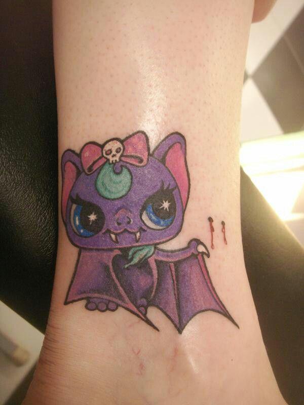 Cute little bat tattoo