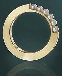 """Quarter"" Andrea Brachthäuser Ring  Only pinning this because I thought it was a roll of tape with a portion taken out and replaced with pearls lol"