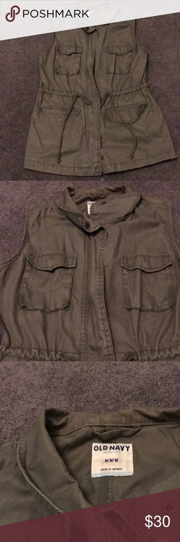 OLD NAVY VEST Old Navy twill-cargo vest in olive green. Longer in length. 4 pockets. 2 ties at the waist if you are looking to tighten for shape. Perfect for fall weather. Great condition, no rips/ tears/ stains. Size medium. Old Navy Jackets & Coats Vests