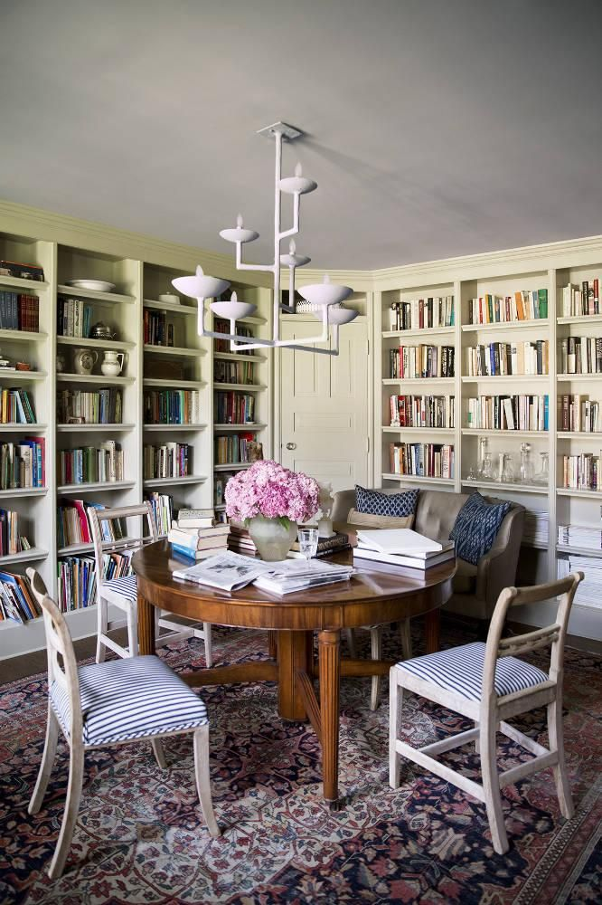 A Giacometti Style Fixture Gives This Traditional Library Dining Room Boost