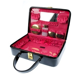 A 1960's patent leather vanity case