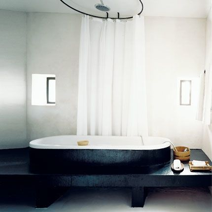 classic clawfoot baths with black-painted exteriors