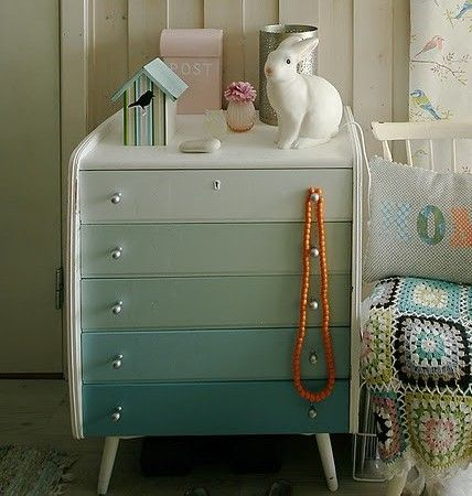 A gradient chest of drawers. Use tester pots of paint the front of each drawer.