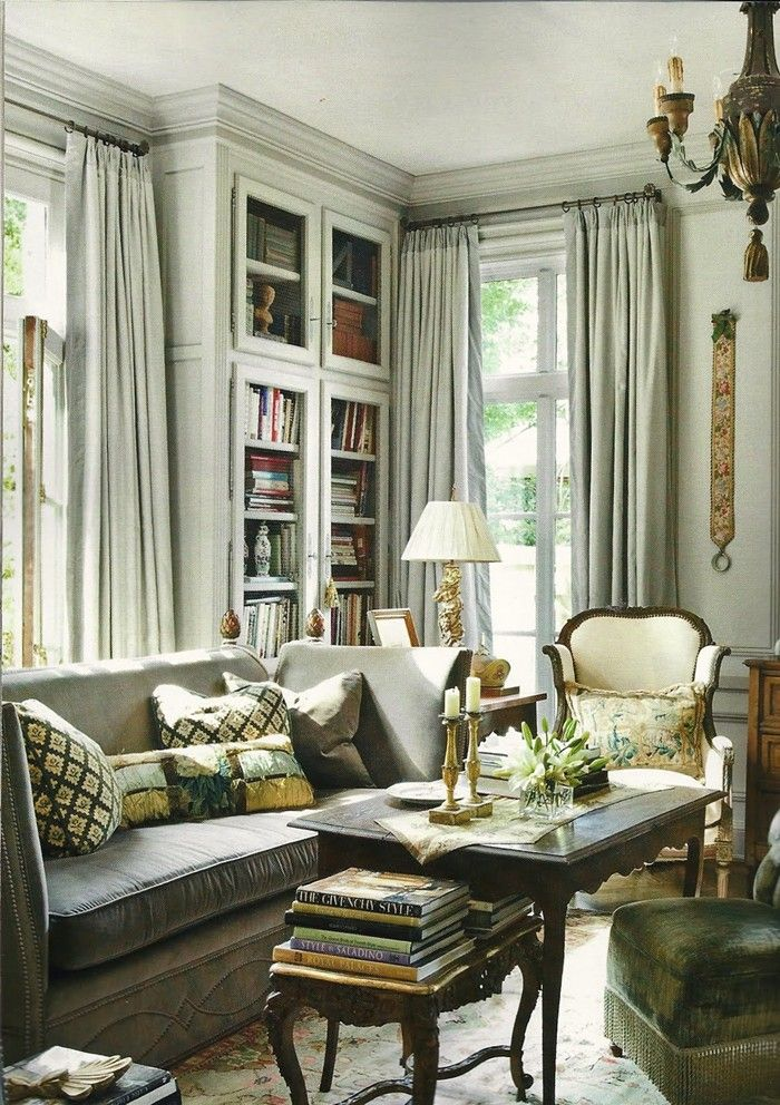 elegant, great bones, lived-in and comfortable, living-room-decor-in-grays-elegant-bookcase-gilded-accents