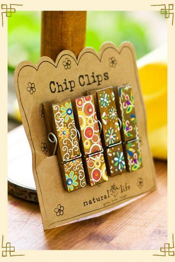 adorable chip clips ... fabulous idea, can make your own! Find the clips and mod podge scrap book paper on it!