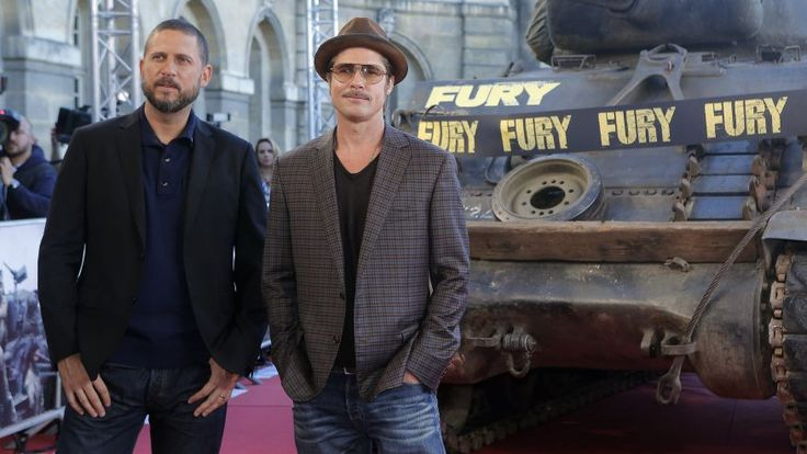 """Brad Pitt and director David Ayer pose for photographers during the photocall of """"Fury"""" in Paris. October 18, 2014."""