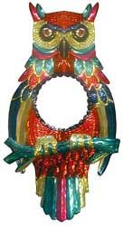 Mexico has long been known for its colorful and uniquely original tin mirror frames, and this darling Owl mirror proves precisely why.  Hand-punched and hand-painted in Oaxaca, Mexico, its bold colors will revitalize even the drabbest of walls.  It's the perfect way to embrace your own Mexican or Southwestern spirit, and to bring out the interior decorator in all of us!  Also makes a striking yet inexpensive gift that will be cherished for years.