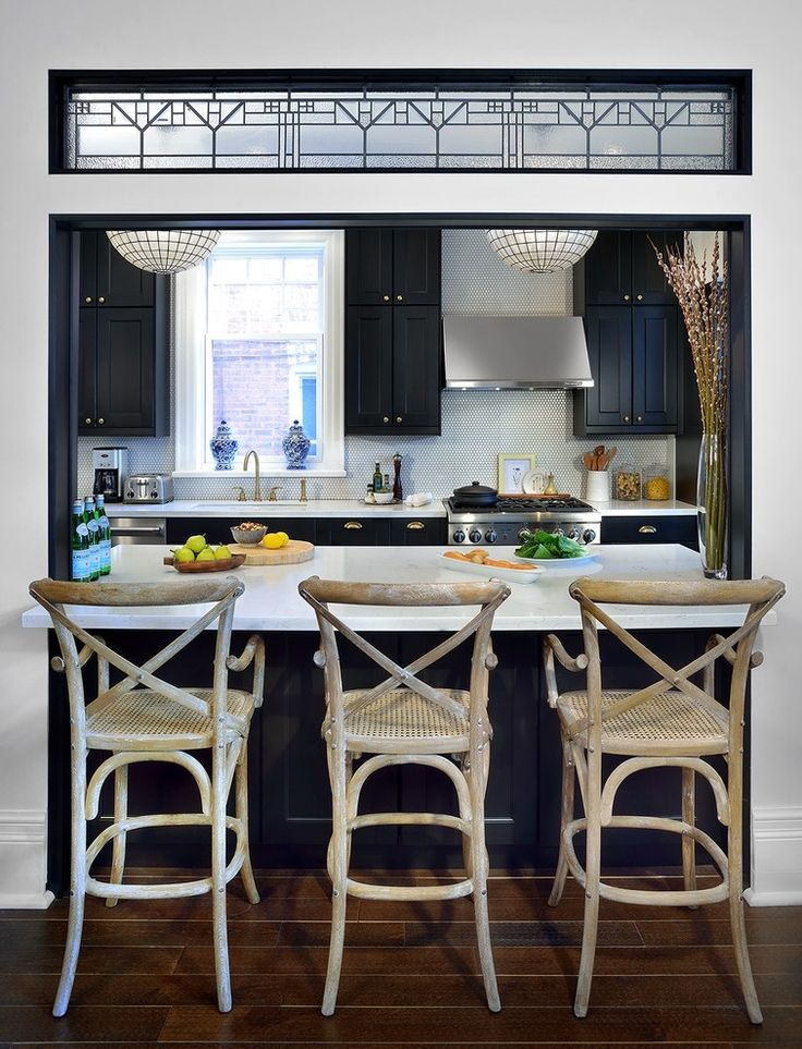 Kitchen Wall Cut Out Breakfast Bar With Black Cabinets, White Countertops  And Wicker Bar Chairs Part 60
