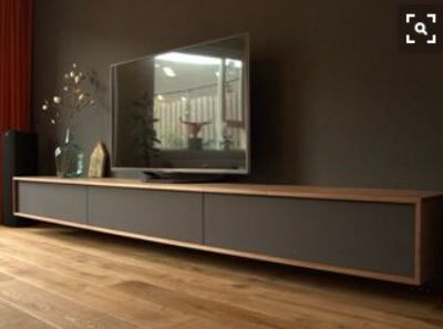 SHELVING Floating dark cabinet with timber trim.