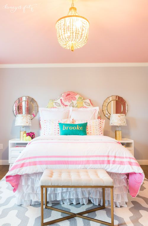 This modern, chic girls room features gold accents and a FAB pink ceiling!