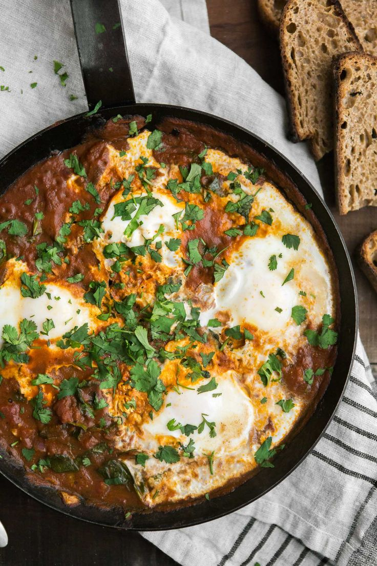 A hearty, one-pan dish with curried eggs in tomato sauce and fresh spinach. Perfect for breakfast or dinner, served with toast or over grains.