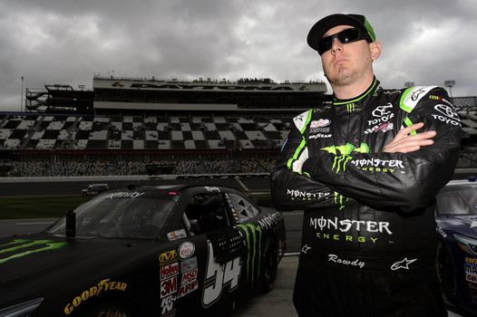 Kyle Busch, driver of the #54 Monster energy Toyota, looks on from the grid during qualifying for the NASCAR XFINITY Series Alert Today Florida 300 at Daytona International Speedway on February 21, 2015 in Daytona Beach, Florida