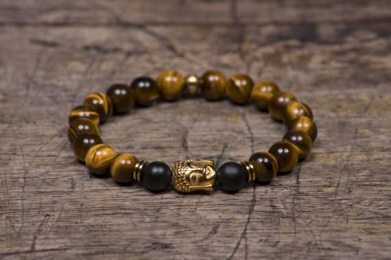 Buda de oro ojo de tigres