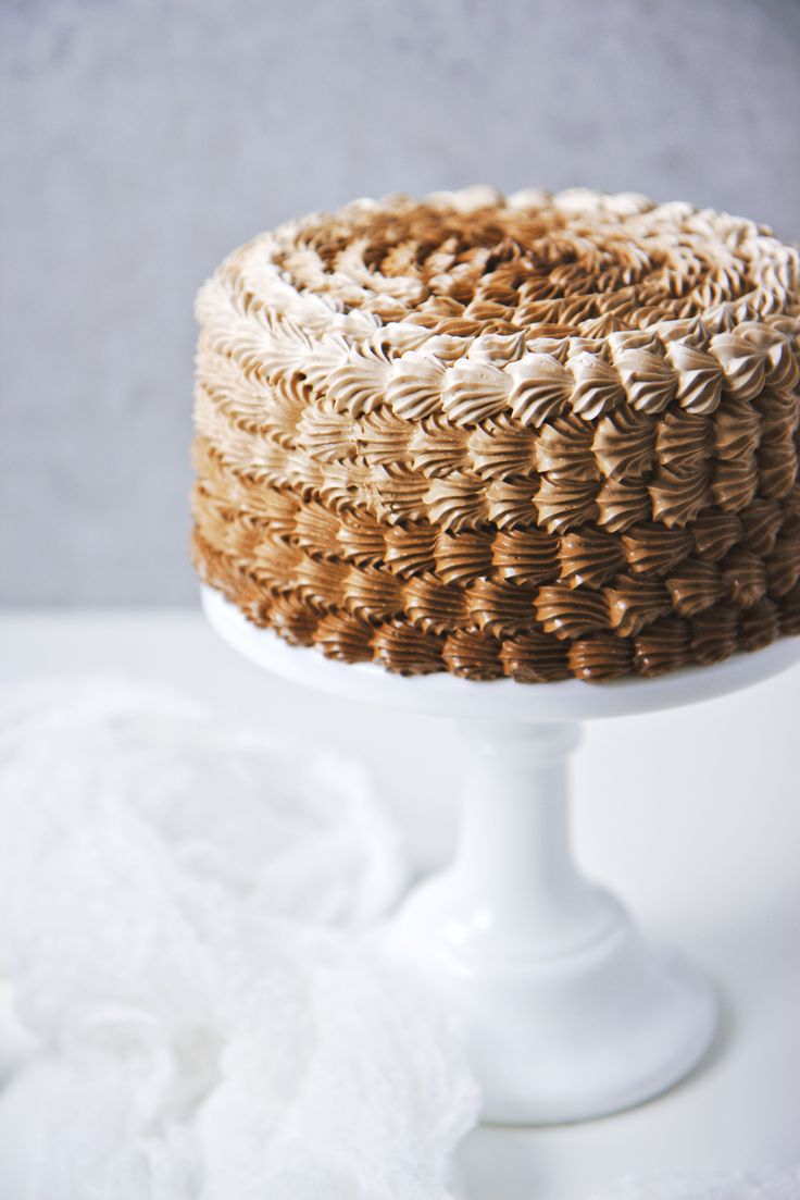 Banana Cake with Almond Dacquoise, Coffee Pastry Cream, and Chocolate Meringue Buttercream