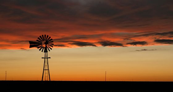 Oklahoma landscape at sunset with windmill