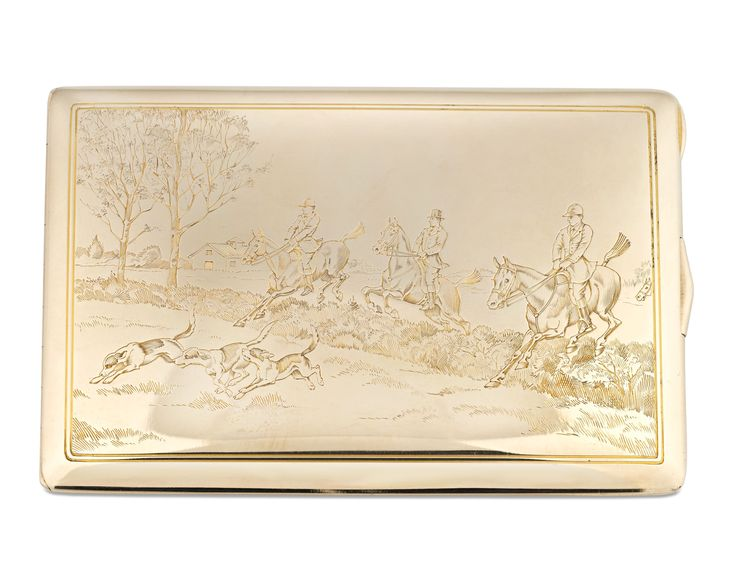An energetic hunting scene is intricately etched onto the cover of this stylish 14k gold cigarette box crafted by Tiffany & Co. Considered an essential part of ladies' fashion beginning in the 1910s, cigarette boxes such as this were among the most stylish items created by Tiffany during the early 20th century.