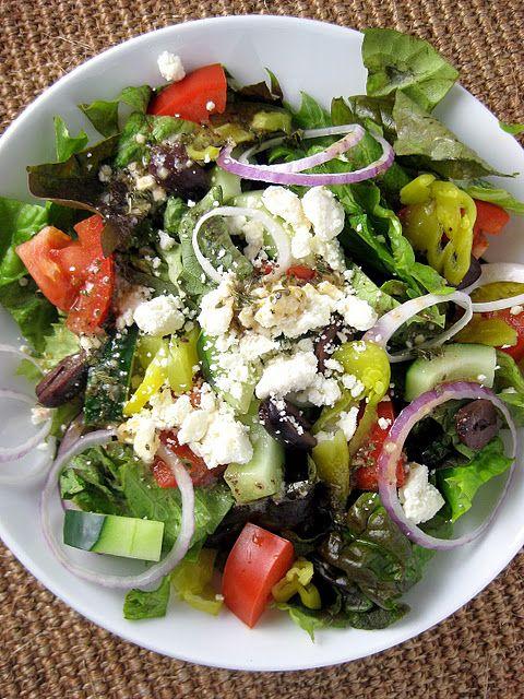 Tossed Greek Salad with Greek Vinaigrette - Lettuce, tomato, cucumber, red onion, olives, pepperchini, feta cheese