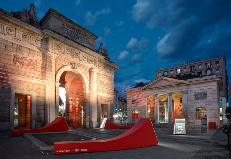 The installation of Migliore+Servetto Architects inside Tecno's showroom is composed by a dense network of red, spatial links, that emerges from the Caselli, home of the Milanese showroom, and embraces the outside piazza, thus building an unprecedented  connection between the two Caselli, on the occasion of Milan Design Week 2016.