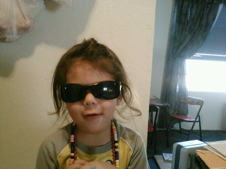 My 3 yr old wearing my sunglasses