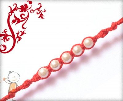 Mauli #Rakhi Collection 2015 – Send #Rakhi to #India, #USA, #UK, #Canada, #Australia, #Dubai #NZ #Singapore.  Simple Pearl Design Rakhi, surprise your loved ones with roli chawal, chocolates and a greeting card as it is also a part of our package and that too without any extra charges. http://www.bablarakhi.com/send-fancy-rakhi-online/895-send-simple-pearl-design-rakhi-online.html