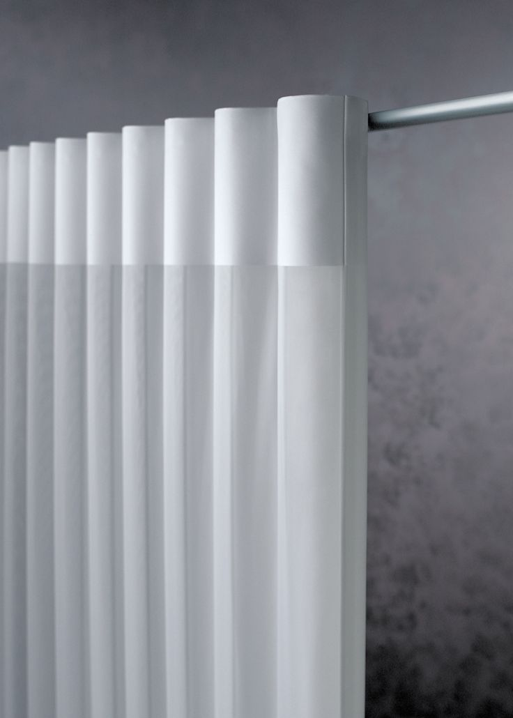 The softness and femininity of Luminette Curtains by NY City Blinds shown on a rod.