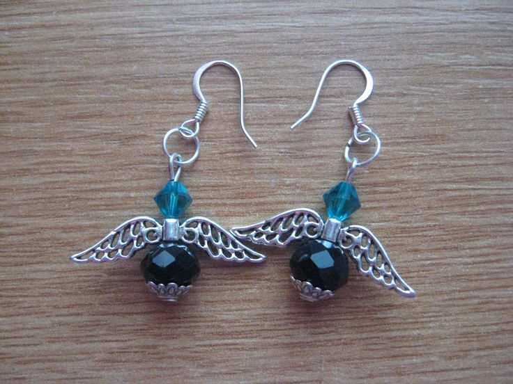 earring with wing, blue swarovski and semi precious black stone