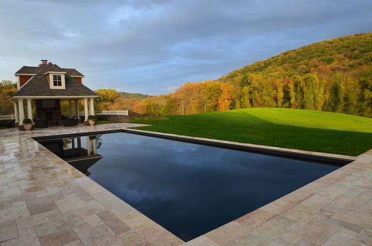 The Topography In Contrast To The Clean Straight Lines Of The Pool Staggeringly Beautiful