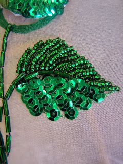 stitching in the pursuit of happiness: March 2012 Leaf, nap indicated with beads on one half and sequins on the other