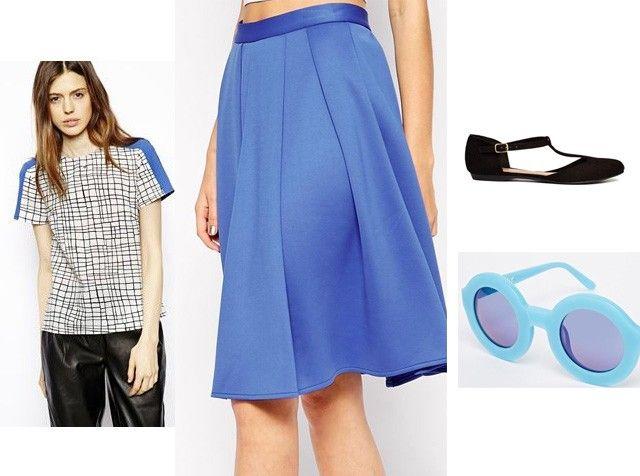 Like the skirt. Gestreepte blouse van Asos (27,14 euro), blauwe rok van Asos (40 euro), schoenen via Asos (22,84 euro) en zonnebril van Wildfox (196,43 euro...