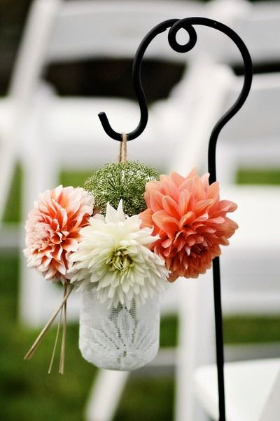 Bright wedding ceremony aisle marker idea - waterfront ceremony with peach + white dahlias in lace-lined mason jar {Hannah Marie Photography}