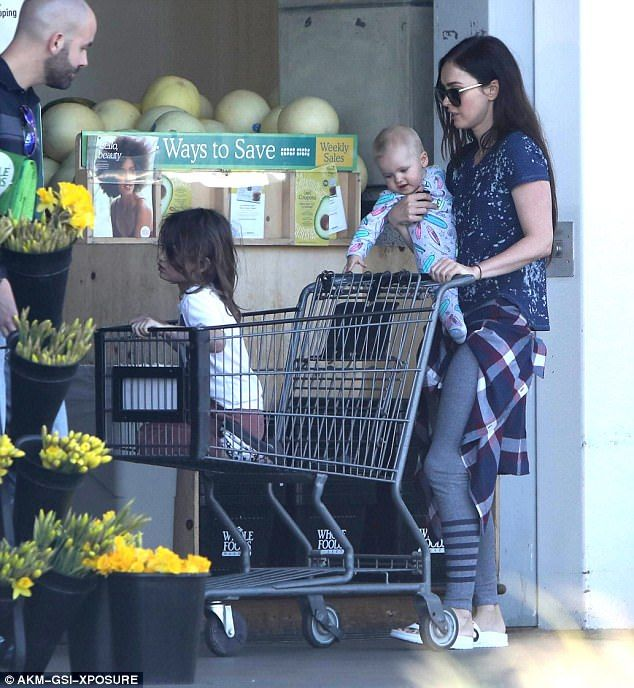 Stocking up: The celebrity mommy held onto Journey, seven months, while letting Noah ride ...
