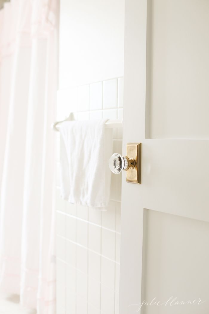 Door hardware...Home blogger Julie Blanner shares her ideas for updating a dark, dated hall