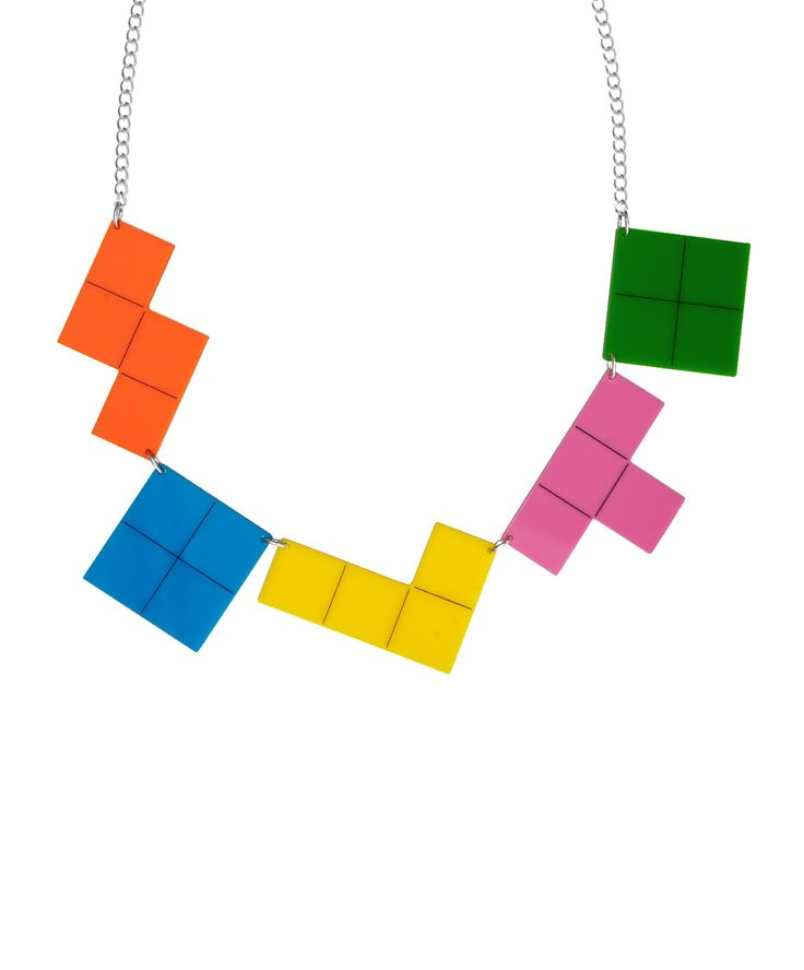 Flashback to original 80s screen addictions with the Video Game Necklace. Graphic gaming blocks are laser cut in colourful acrylic and hand linked on a golden chain. Show the world you're a fan of the