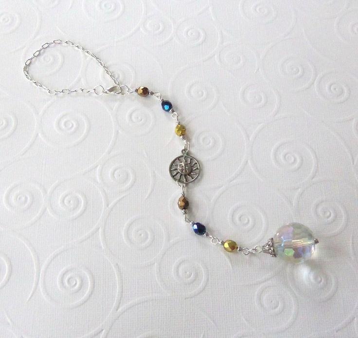 Celestial Sun Crystal Bead Suncatcher / Car Charm. $7.99, via Etsy. glass beads: http://www.ecrafty.com/c-2-glass-beads.aspx