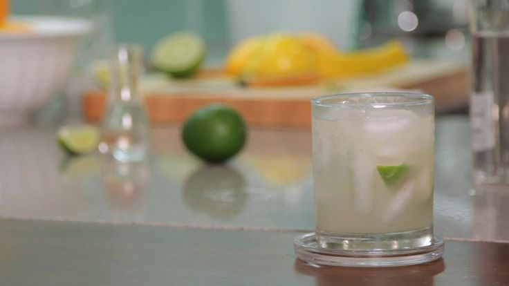 Caipirinha - 2 teaspoon sugar, half lime muddled, 2 oz rum, shake and pore into frozen glass