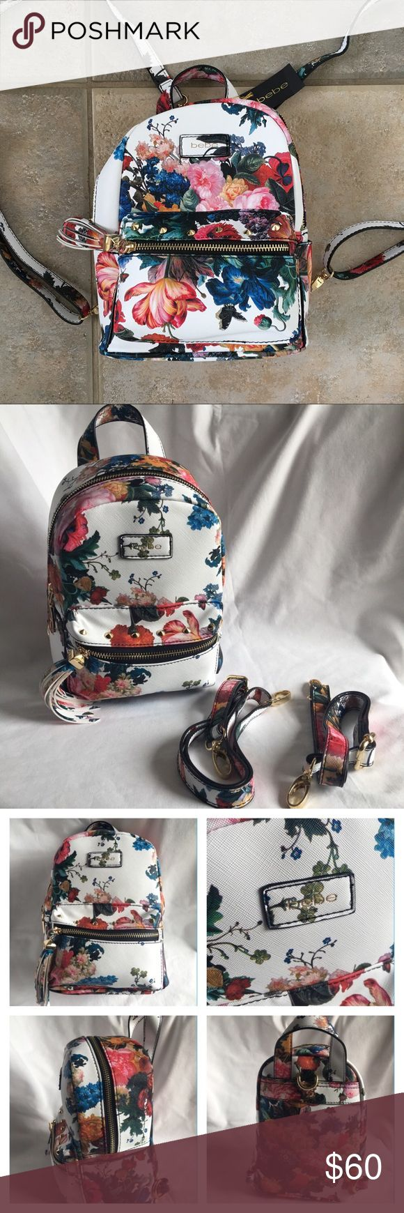 """bebe Mini Floral Backpack Melissa White NWT Brand new backpack/purse, never worn, with tag. Tag does not include original price, was a gift. Desiner: bebe Color: White with floral pattern Style: Mini Backpack Melissa Material: Canvas /PVC/Polyvinyl Chloride (exterior); Polyester (lining) Height: 9 1/2"""" inches Width: 8"""" inches Length: 5"""" inches Detachable shoulder straps bebe Bags Backpacks"""
