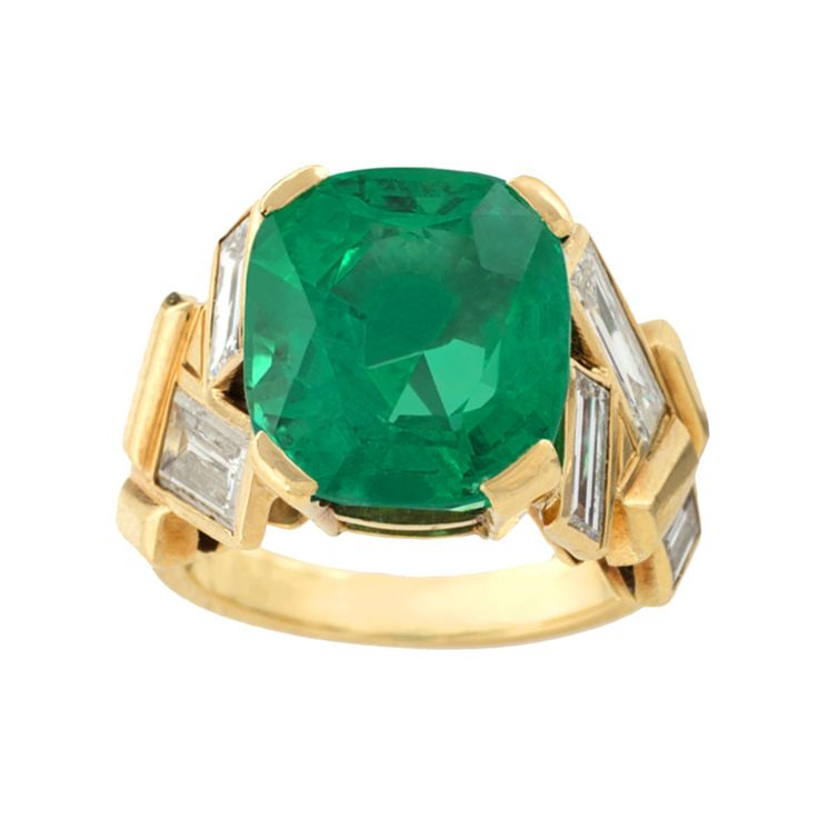 Suzanne Belperron Emerald Diamond Gold Ring A French Mid-20th Century 18 karat gold ring with emerald and diamonds by Suzanne Belperron. The ring centers on a very fine modified cushion-cut emerald with a weight of 7.62 carats, and 6 baguette cut diamonds with an approximate total weight of 2.40 carats, F/G color and VS clarity AGL Certificate #CS55049 stating of Colombian origin.