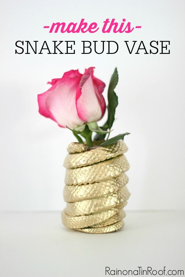 Buy a rubber toy snake for $1 and turn it into a chic and golden DIY snake bud vase! Its easy and unique!