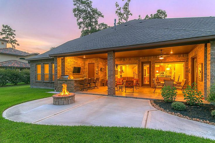 Expansive back porch has outdoor kitchen with granite counter-top, air conditioned chef's pantry,compact refrigerator, fire pit, large screen tv mountings, five stereo speakers  and multiple seating areas for entertaining.
