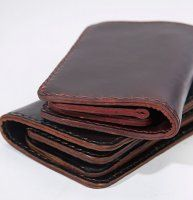 Horsehide Portfolio #Wallet Our #EXCLUSIVE # 13 wallet is totally handmade from genuine Horween® #Horsehide leather. With close to 3-hours of hand punching and #sewing going into this wallet, it is truly a unique item that you want find anywhere else. This is not your average wallet and don't expect this to fit in your back pocket with ease. It is thick, bold and thoughtfully designed with superior #craftsmanship.