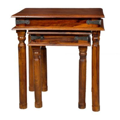 The 'Maharaja' range is crafted from solid sheesham wood, a type of Indian rosewood that is not only durable but also retains the unique colours and imperfections of the grain which give it such beautiful, natural character. This nest of tables are typical of traditional Indian 'Thakat' design with ornate turned legs and contrasting iron detail creating a distinctive and charming look.