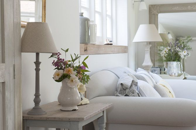 Pretty styling in calm, chalky neutrals in Melanie Marchant's pretty English cottage